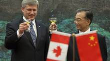 Prime Minister Stephen Harper takes part in a toast with Wen Jiabao, Premier of the People's Republic of China, following a signing ceremony at the Great Hall of the People in Beijing, China on Thursday, December 3, 2009. (Sean Kilpatrick/The Canadian Press)