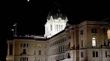 The moon is seen, during a phase of a total lunar eclipse, over the Saskatchewan Legislature February 20, 2008. (TODD KOROL/REUTERS)