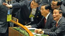 President Hu Jintao and Chinese officials listen to proceedings at the United Nations summit on climate change in New York on Sept. 22, 2009. (TIMOTHY A. CLARY/AFP/Getty Images)
