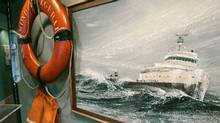 A life ring and life vest hang in an exhibit along with a painting of the Edmund Fitzgerald in rough Lake Superior waters in a display at the Lake Superior Maritime Museum in Duluth, Minn. (Jim Mone/AP)