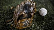 "Brett Lawrie is known as a ""dirt bag,"" - a player who does not hesitate to get himself and his gear dirty. His two-year-old glove reflects that. (Mark Blinch For The Globe and Mail)"