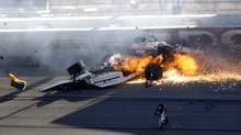 In this Oct. 16, 2011, file photo, drivers Dan Wheldon, front, and Will Power crash during a wreck that involved 15 cars during the IndyCar Series' auto race at Las Vegas Motor Speedway in Las Vegas. Wheldon died following the crash. (Jessica Ebelhar/Jessica Ebelhar/Las Vegas Review-Journal/AP)