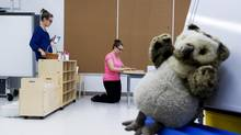 Librarian Lindsay Keith, left, helps teacher Stephanie Hammond, right, prepare her classroom at Fraser Mustard Early Learning Academy, which expects 685 students at the all-kindergarten school, in Toronto on Aug. 29, 2013. (Michelle Siu/The Globe and Mail)