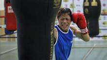 India's boxer Mangte Chungneijang Merykom punches a bag during a training session at Balewadi Stadium in Pune, india, this past March. Ms. Merykom was the face of the campaign to get women's boxing into the Olympics. (Danish Siddiqui/Reuters)