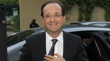 France's newly-elected President Francois Hollande arrives at his apartment in Paris May 7, 2012, a day after the French presidential election. (Gonzalo Fuentes/REUTERS/Gonzalo Fuentes/REUTERS)