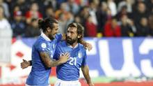 Italy's Stephan El Shaarawy (L) and teammate Andrea Pirlo celebrate a goal against Armenia during their 2014 World Cup qualifying soccer match in Yerevan October 12, 2012. (DAVID MDZINARISHVILI/REUTERS)