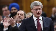 Stephen Harper speaks in the House of Commons on Jan. 27, 2014. (CHRIS WATTIE/REUTERS)