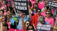 "Participants shout slogans and display placards during a rally to ""stand up for women's health"" at the National Mall in Washington, DC, on April 7, 2011. (Jewel Samad/AFP/Getty Images/Jewel Samad/AFP/Getty Images)"