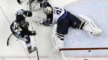 Pittsburgh Penguins' Kris Letang backhands a goal past Winnipeg Jets goalie Ondrej Pavelec Feb. 11, 2012. (Gene J. Puskar/Associated Press/Gene J. Puskar/Associated Press)