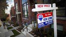 A 'For Sale' sign outside townhouses in the Fairview neighbourhood of Vancouver, March 4, 2013.\ (Rafal Gerszak For The Globe and Mail)