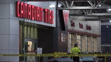 "Police are seen outside a Canadian Tire store in Vancouver, B.C. Thursday, Nov. 10, 2016. Vancouver police responded to what they called a ""serious"" incident at a Canadian Tire store Thursday afternoon on the city's Eastside. (JONATHAN HAYWARD/THE CANADIAN PRESS)"