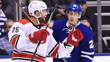 Carolina Hurricanes' Viktor Stalberg (25) celebrates his goal as Toronto Maple Leafs' Nikita Zaitsev (22) looks on during second period NHL hockey action in Toronto on Tuesday, November 22, 2016. (Frank Gunn/THE CANADIAN PRESS)