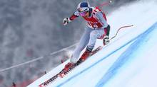 Canada's Erik Guay speeds down the course on his way to take fifth place in an alpine ski, men's World Cup Super-G, in Kitzbuehel, Austria, Friday, Jan. 25, 2013. (Alessandro Trovati/AP)