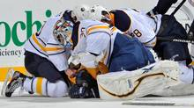 Goalie Ryan Miller of the Buffalo Sabres punches Jordin Tootoo of the Nashville Predators at the Bridgestone Arena on December 3, 2011 in Nashville. (Frederick Breedon/2011 Getty Images)