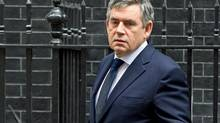 British Prime Minister Gordon Brown leaves 10 Downing Street in London on Oct. 14, 2009. (LEON NEAL)