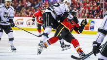 Los Angeles Kings center Trevor Lewis (22) and Calgary Flames left wing Matthew Tkachuk (19) collide during the third period at Scotiabank Saddledome in Calgary, March 29, 2017. (Sergei Belski/USA Today Sports)