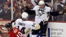 Ottawa Senators' Jason Spezza (L) skates to the bench past a jubilant Pittsburgh Penguins' Chris Kunitz (C) and Sidney Crosby as they celebrate a goal during the second period of game four of their NHL Eastern Conference quarter-final hockey game in Ottawa April 20, 2010. (BLAIR GABLE/REUTERS)