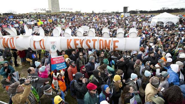 """Protesters gather at the National Mall in Washington calling on President Barack Obama to reject the Keystone XL oil pipeline from Canada, as well as act to limit carbon pollution from power plants and """"move beyond"""" coal and natural gas, Sunday, Feb. 17, 2013. (Manuel Balce Ceneta/AP)"""