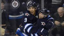 Winnipeg Jets' Kyle Wellwood (R) celebrates his goal against the New York Islanders with Evander Kane during the second period of their NHL hockey game in Winnipeg April 20, 2013. (Fred Greenslade/Reuters)