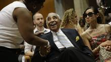 Congressman Charles Rangel, centre, is shown before a graduation ceremony in New York on Monday. Mr. Rangel is facing off against state senator Adriano Espaillat and Rev. Michael Waldon Jr. in the Democratic primary on Tuesday. He has said this campaign will be his last. (Seth Wenig/AP)