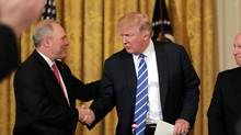 U.S. President Donald Trump shakes hands with House Majority Whip Steve Scalise (L) as he attends a meeting with the U.S. House Deputy Whip team in the East room of the White House in Washington, U.S. March 7, 2017. (CARLOS BARRIA/REUTERS)