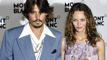 Actor Johnny Depp and Vanessa Paradis arrive on the red carpet for the 100th anniversary of Swiss watch and luxury goods maker Montblanc at Palexpo in Geneva, Switzerland in this April 5, 2006, file photo. Depp has separated from his partner of 14 years, French singer and actress Vanessa Paradis, a representative for the actor said on June 19, 2012. (DENIS BALIBOUSE/Reuters)