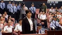 This video image taken from CCTV shows Gu Kailai, centre, the wife of disgraced politician Bo Xilai, standing trial in the Intermediate People's Court in the eastern Chinese city of Hefei on Aug. 9, 2012. (CCTV via APTN/AP)