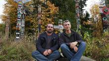 Australian Indigigenous Ranger Daniel Oades and Patrick O'Leary , right, a spokesman for the Pew Environment Group, sit near the totem poles in Stanley Park in Vancouver October 28, 2012. (Jeff Vinnick for The Globe and Mail)