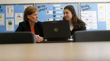 Roberta Longpré, Head Student Services of Branksome Hall, talks to Grade 12 student Kimmie Green at the learning centre. (Fernando Morales/The Globe and Mail)