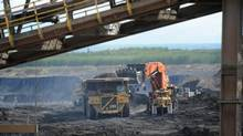 Heavy machinery operates at the Shell Albian Sands north of Fort McMurray, Alta. (Kevin Van Paassen/The Globe and Mail)