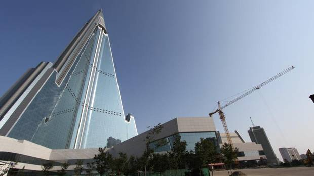 The 105-storey, pyramid-shaped Ryugyong Hotel remains unfinished more than 20 years after construction began. (AP)