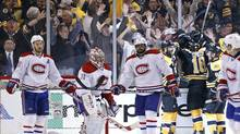 Montreal Canadiens defenseman Josh Gorges (26), goalie Carey Price (31) and defenseman P.K. Subban (76) react as fans celebrate with Boston Bruins right wing Reilly Smith (18), center Patrice Bergeron (37) and Brad Marchand (63) after Smith's goal during the third period in Game 2 of an NHL hockey second-round Stanley Cup playoff series against the Montreal Canadiens in Boston, Saturday, May 3, 2014. The Bruins won 5-3 to even the best-of-seven games series at one game apiece. (Elise Amendola/AP)