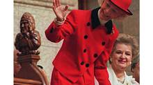 (OTT 101)OTTAWA, Mar 24--Barbara Ann Scott, former Olympic and world champion figure skater and considered Canada's first lady figure skater, waves to House of Commons speaker Gilbert Parent in the House of Commons in Ottawa Friday. (Tom Hanson/CP)