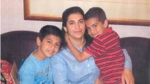 Randa Hammadieh is seen here with her two children Louis Gallego- Hammadieh (9) and Benny Gallego- Hammadieh (8) in this undated handout photo. Peel Regional Police have issued an Amber Alert for two brothers, aged 8 and 9, allegedly abducted by their mother from Brampton, Ont. (Peel Regional Police/The Canadian Press)