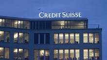 This Dec. 9, 2008, file photo shows a building of Credit Suisse bank in the Brunau district of Zurich, Switzerland. Swiss bank Credit Suisse said Monday, Sept. 19, 2011, it has agreed to a settlement to prevent its staff from being prosecuted in a German tax evasion case. (Gaetan Bally/AP) (GAETAN BALLY/Gaetan Bally/AP)