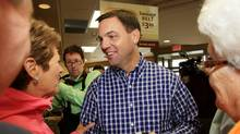 Ontario Conservative leader Tim Hudak talks to people at a campaign stop at a Tim Hortons coffee shop in Blenheim, Ontario, Monday, October 3, 2011. (THE CANADIAN PRESS / Dave Chidley/THE CANADIAN PRESS / Dave Chidley)