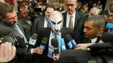 Boris Berezovsky, centre, talks to journalists after leaving Bow Street Magistrates Court in London in 2003, wearing a mask showing the face of Russia's President Vladimir Putin. Mr. Berezovsky was arrested in Britain on March 25, 2003 with Yuly Dubov, a co-director and former chief executive of the Logovaz car company, after Russian officials sought his extradition on $1.9-billion fraud charges. (PETER MACDIARMID/REUTERS)