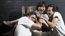 "Sook-Yin Lee, centre, poses for a photo with fellow artists-in-residence of SummerWorks Performance Festival and co-creators of the multi-media piece ""How Can I Forget?"" Adam Litovitz, left, and Benjamin Kamino, right, in Toronto on Monday, August 5, 2013. (Michelle Siu/The Globe and Mail)"