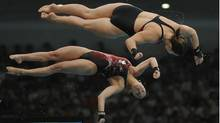 BEIJING.AUG.12.2008Canadian women's synchronized 10m platform pair Roseline Filion,top, and Meaghan Benfeito,lower, placed seventh in the event won by the Chinese. (Fred Lum)