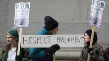 Anti-prorogation protesters gather outside the C.D. Howe Institute in Toronto, where Prime Minister Harper attended a roundtable meeting on Wednesday, Jan. 20, 2010. (CHRIS YOUNG)