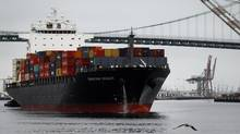 A container ship departs the Port of Los Angeles in San Pedro, Calif., in this file photo. (Patrick T. Fallon/Bloomberg)