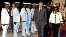 Prime Minister Stephen Harper arrives in Port of Spain, Republic of Trinidad and Tobago, as he is greeted by Ministry of Foreign Affairs Protocol Officer Maxine Barnett on Thursday November 26, 2009. (Sean Kilpatrick)
