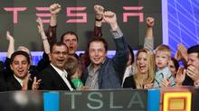 CEO of Tesla Motors Elon Musk waves after ringing the opening bell at the NASDAQ market (BRENDAN MCDERMID/REUTERS)