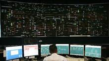 An operator works in the control room at the Independent Electricity System Operator facility in Mississauga, Ont. (ADRIAN WYLD/CP)