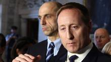 ustice Minister Peter MacKay talks to reporters as Public Safety Minister Steven Blaney looks on in Ottawa, on Wednesday February 26, 2014. (FRED CHARTRAND/THE CANADIAN PRESS)