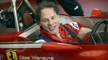 Jacques Villeneuve sits in the cockpit of his father's car at the Fiorano track. (Ercole Colombo/AP)