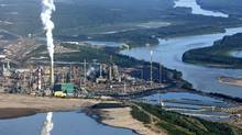 Suncor Canada's oil-sands upgrader facility sits on the banks of Alberta's Athabasca River in July of 2006. (Larry MacDougal for The Globe and Mail/Larry MacDougal for The Globe and Mail)