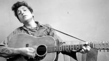 Bob Dylan plays his acoustic guitar in New York in September, 1961. (CBS)