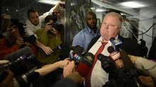 Toronto Mayor Rob Ford makes a statement during a media scrum outside his office at City Hall. (Fred Lum/The Globe and Mail)