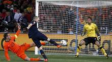 Spain's Andres Iniesta shoots to score against Netherlands during their 2010 World Cup final soccer match at Soccer City stadium in Johannesburg July 11, 2010. (Marcos Brindicci/REUTERS)